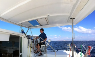 Kake2Kale - Sailing Greece - Hubby At The Helm